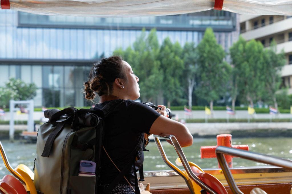 Riding a water taxi, Bangkok, Thailand