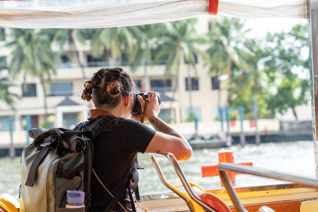 Adrienne photographing along the Chao Phraya, Bangkok, Thailand