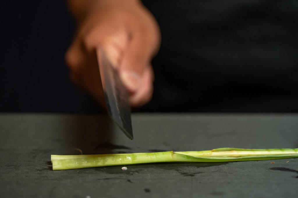 Smash lemongrass (using the back of a knife)