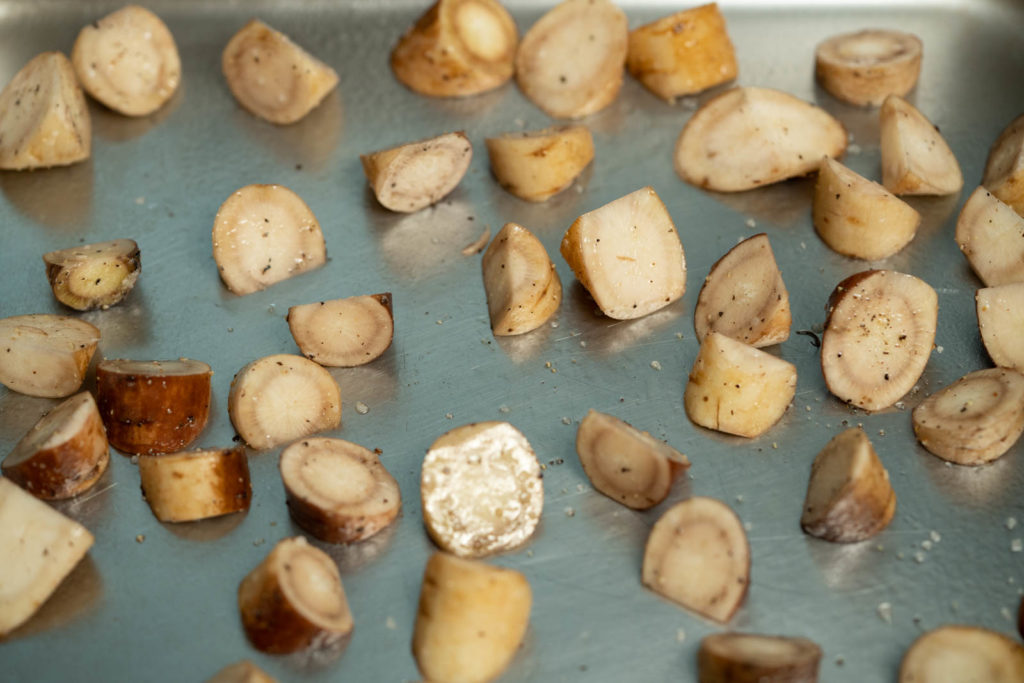 Spread seasoned gobo onto a greased sheet pan