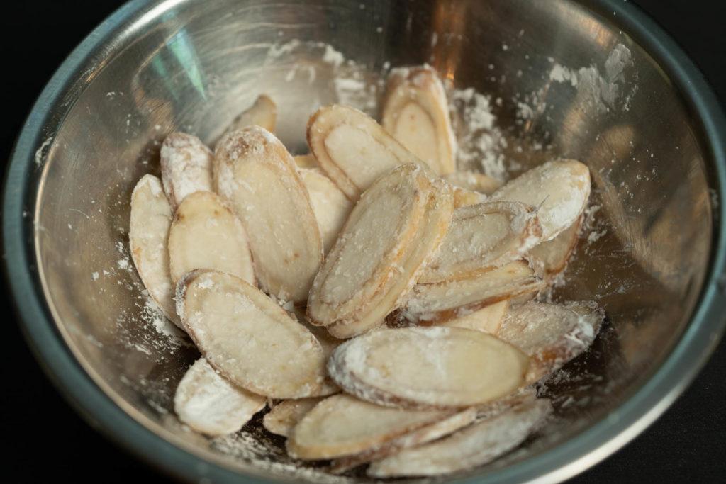 Season slices with cornstarch and salt