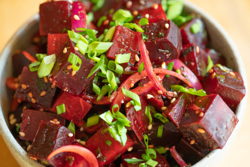 Serve beet poke with extra green onion and sesame seed garnish