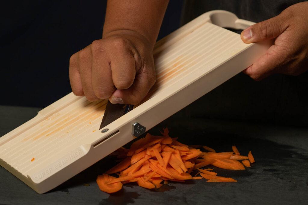 Peel & slice carrots into thin strips