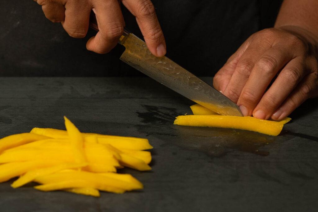 Peel & slice mango into thin strips