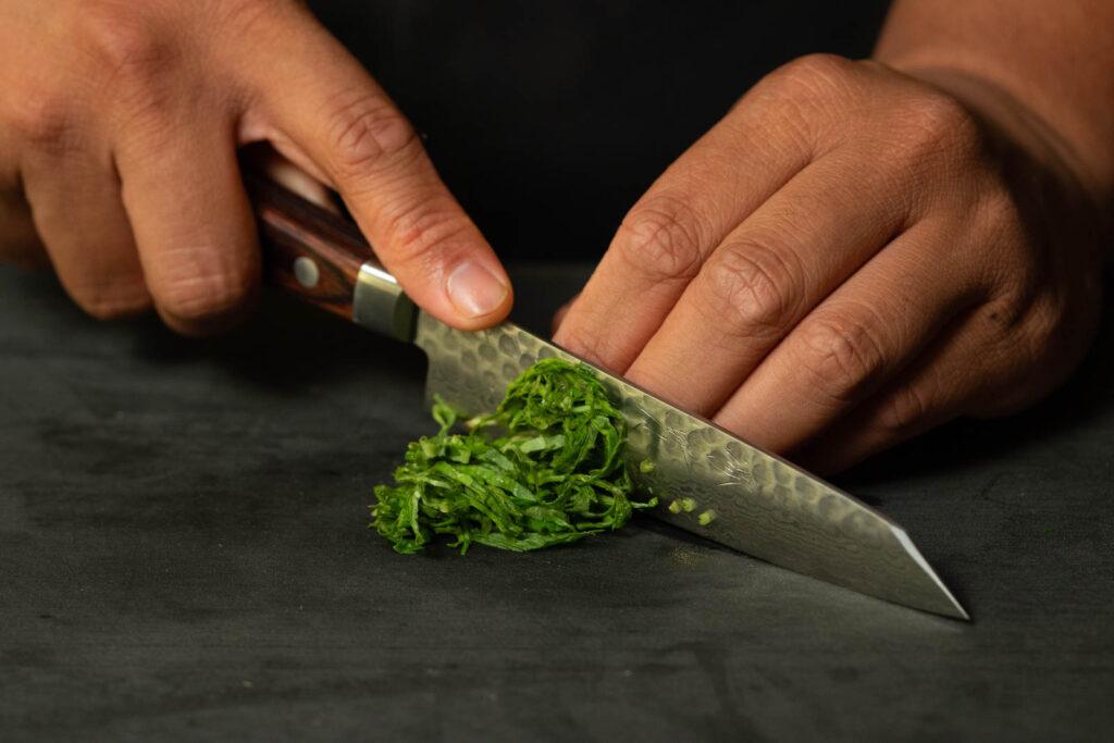 Chiffonade or slice basil