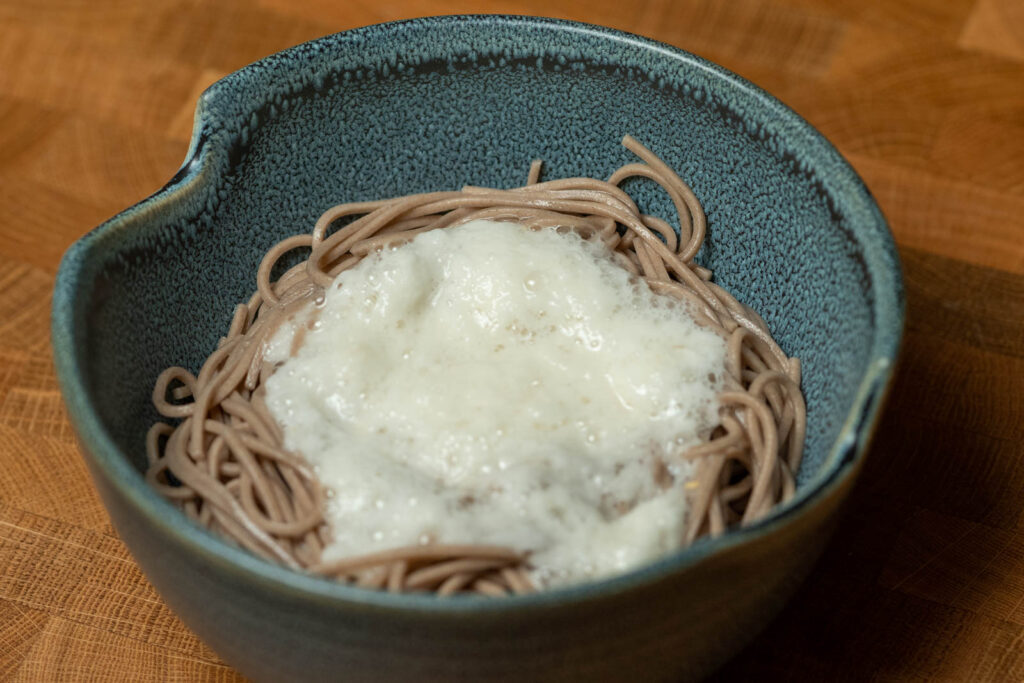Pour tororo on top of noodles