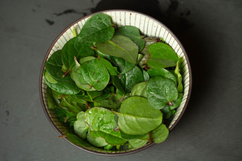 Plate your malabar spinach and mixed field greens