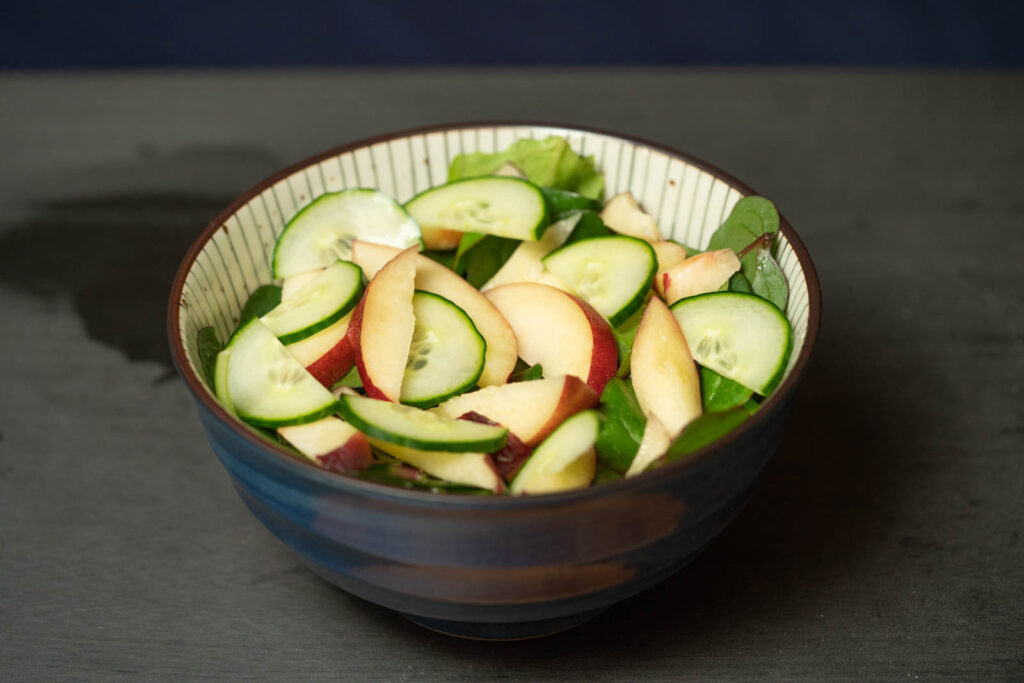 Add your sliced nectarine and cucumber