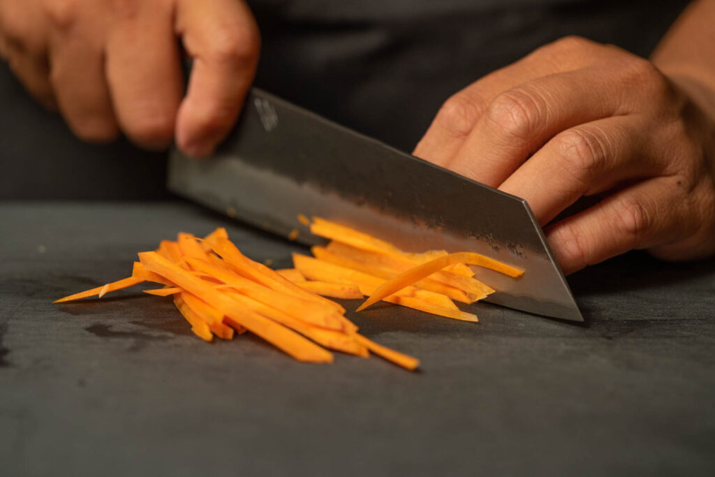 Thinly slice carrots