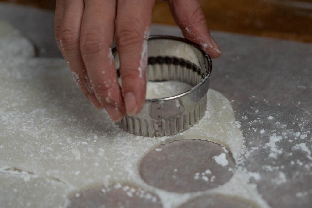 using a cookie cutter to cut mochi