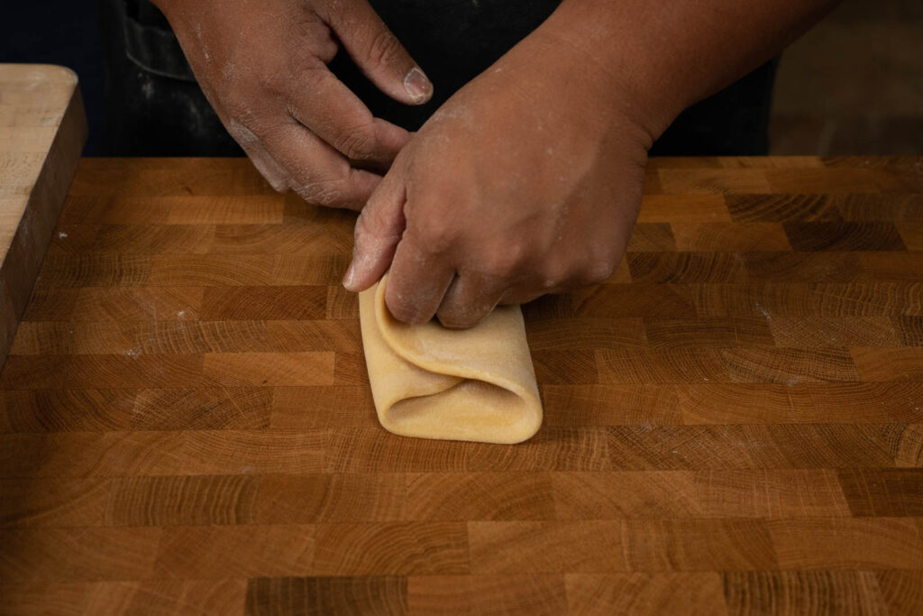 Fold dough in thirds