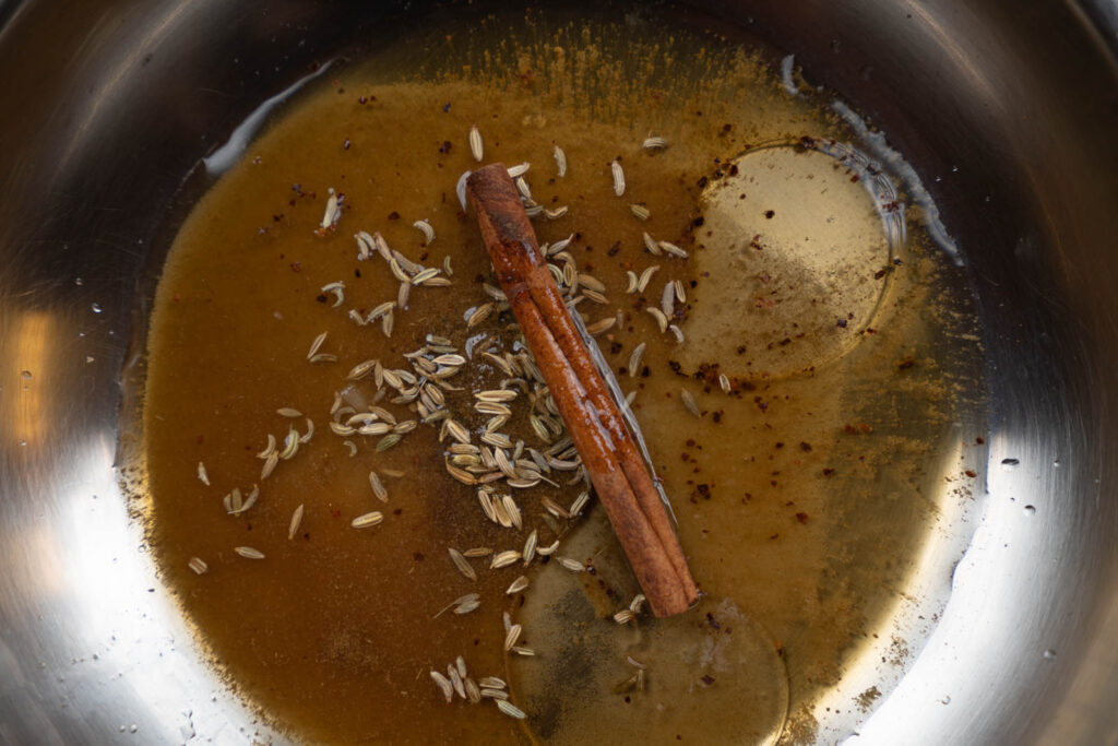 Spices and liquids in a pan