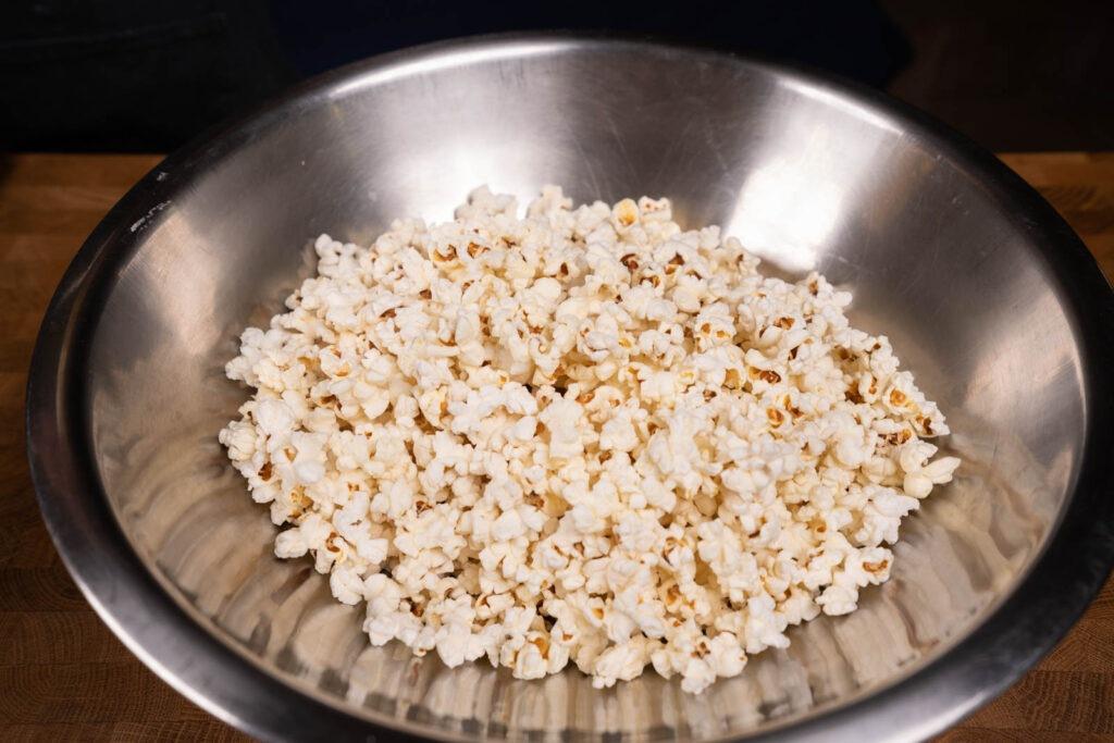 Make popcorn: Place popcorn in large bowl