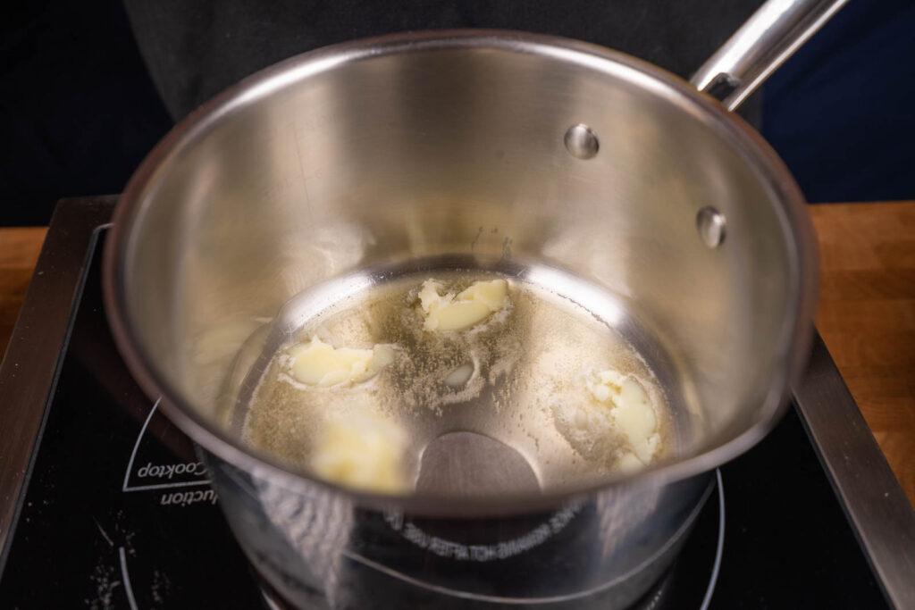 Make popcorn: Melt more butter