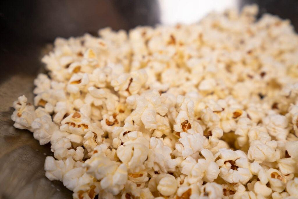 Make popcorn: Add butter to popcorn