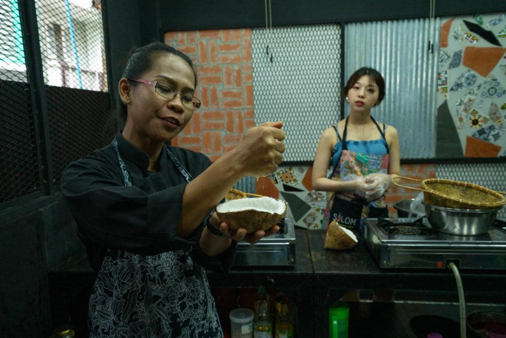 Making coconut milk, Silom Thai Cooking School, Bangkok, Thailand