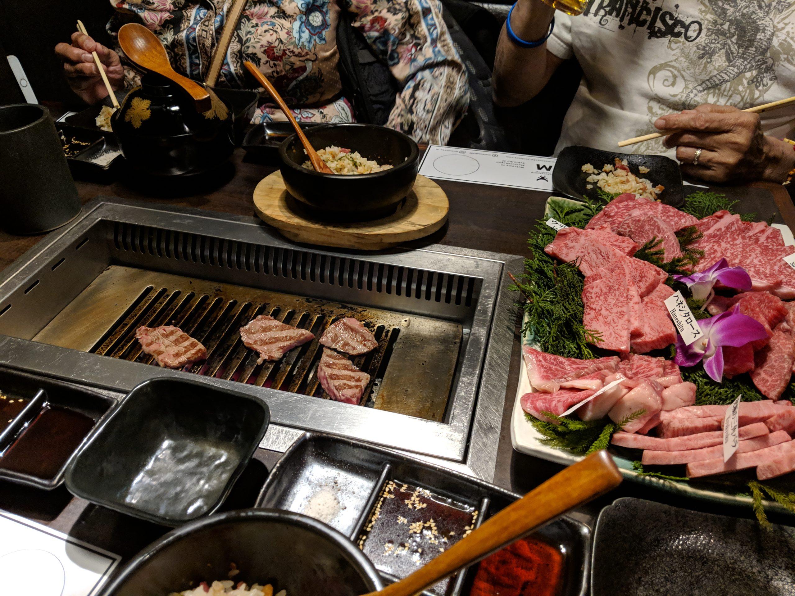 grilling at Matsusakagyu Yakiniku M Hozenji Hanare, Osaka
