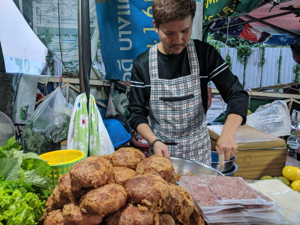 Bang Wa station street food: lettuce wrap. Bangkok, Thailand