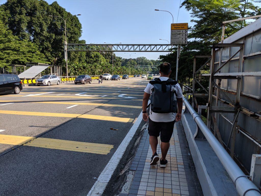 Walking along the freeway, Kuala Lumpur, Malaysia