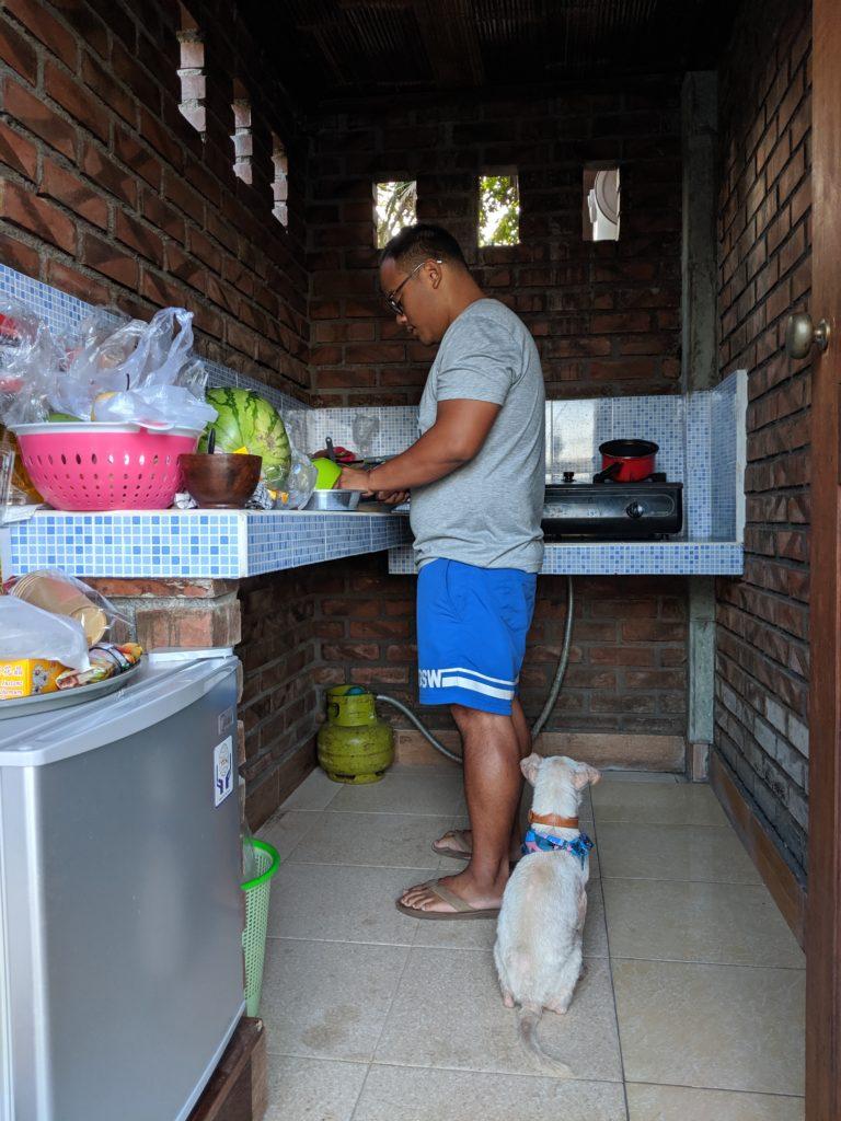 Carl cooking Kacang's food in Bali, Indonesia