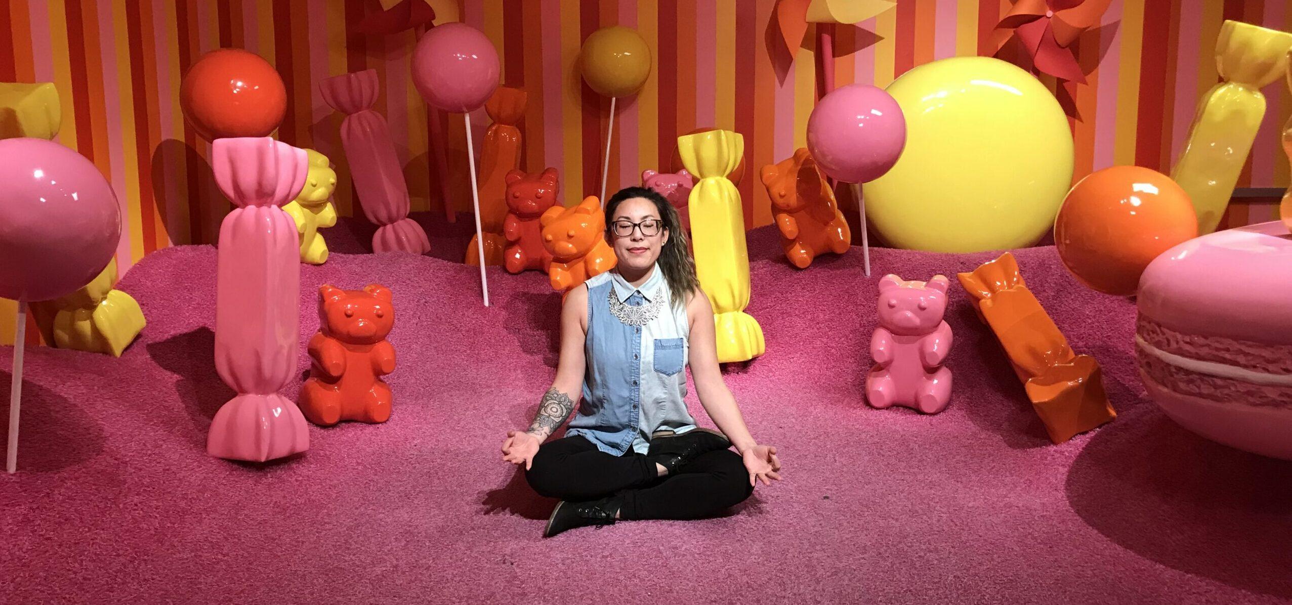 Adrienne meditating at Museum of Ice Cream