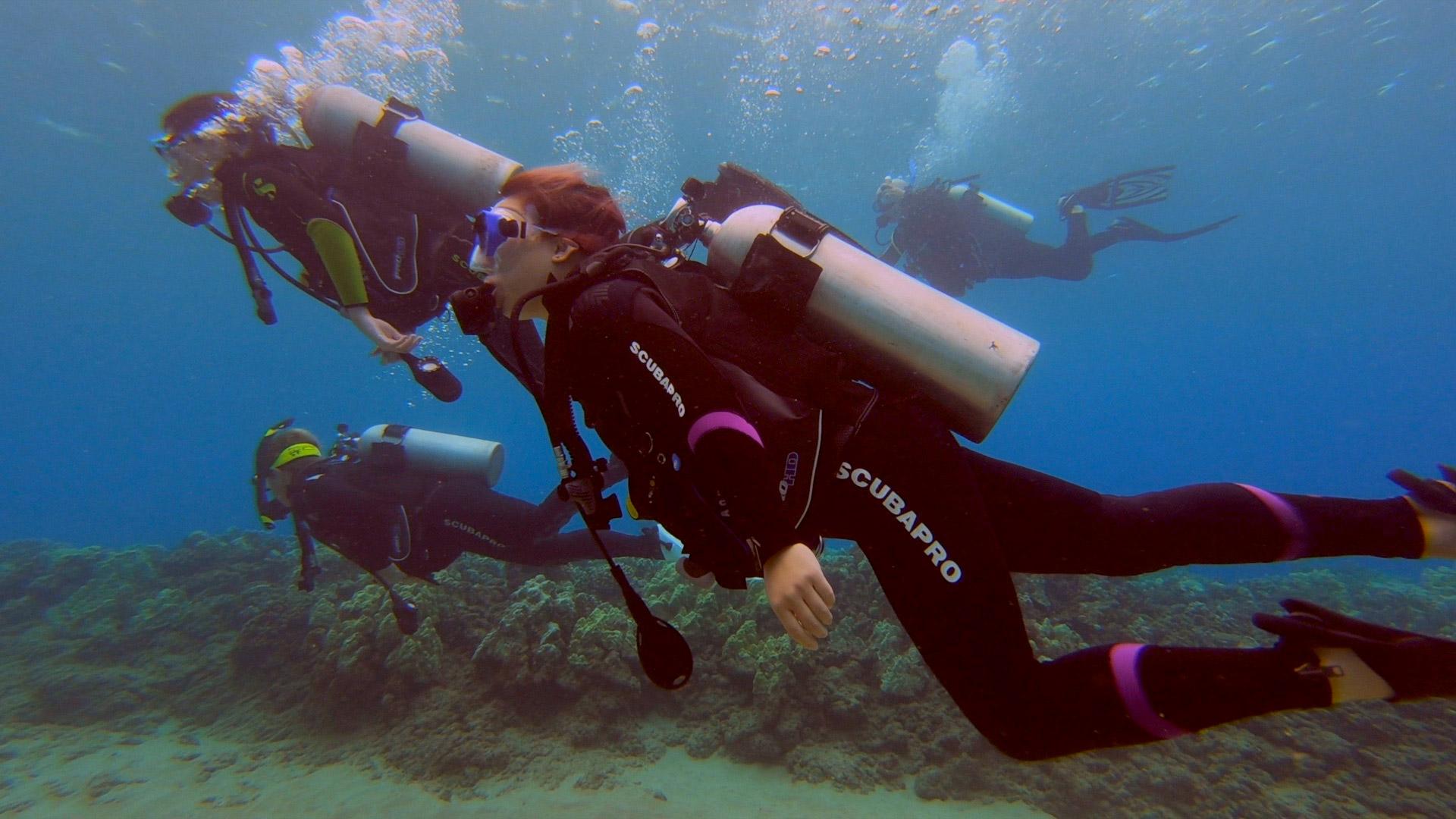 photo of Adrienne scuba diving